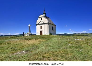 The nun is praying near cross
