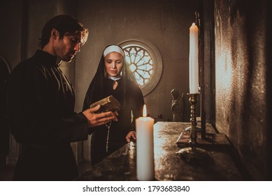 Nun and priest praying and spending time in the monastery