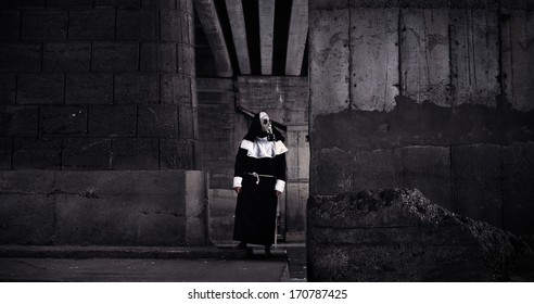 Nun wearing gas mask amongst ruins