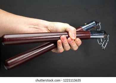 Nunchaku in black background