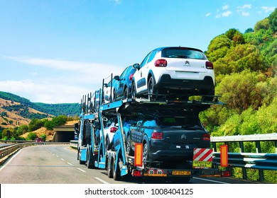 Nuoro, Italy - September 12, 2017: Car transporter on the road, in Nuoro, Sardinia, Italy
