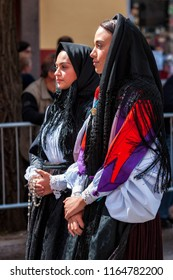 Nuoro, Sardinia, Italy - August 26, 2018: Parade of traditional costumes of Sardinia on the occasion of the Feast of the Redeemer of the Aug. 26, 2018 in Nuoro, Sardinia.