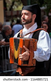 Nuoro, Sardinia, Italy - August 26 2018: Musicians in the parade of traditional costumes of Sardinia on the occasion of the Feast of the Redeemer of the August 26, 2018 in Nuoro, Sardinia.