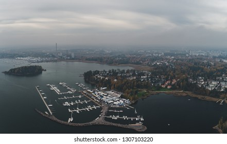 Nuottaniemi marina seen from air on a foggy and moody autumn day, Espoo Finland
