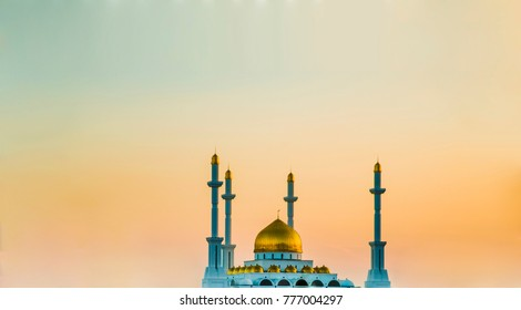 Nur Astana Mosque. White mosque with gold domes. Modern architecture of the capital of the Republic of Kazakhstan. Summer. City landscape