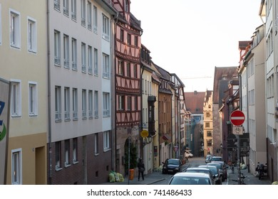 Nurberg, Germany - SEPTEMBER 22, 2016: A view from above of an almost empty narrow alley in Kaiserburg Castle district with caffees, bars, restaurants, shops and cars standing