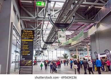 Nurburg, Germany - May 20, 2017: Race track Nurburgring, people in entrance hall - ticket info signboard in front
