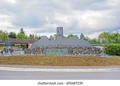 Nurburg, Germany - May 20, 2017: Silhouette of Castle Nurburg near race track Nurburgring at traffic circle