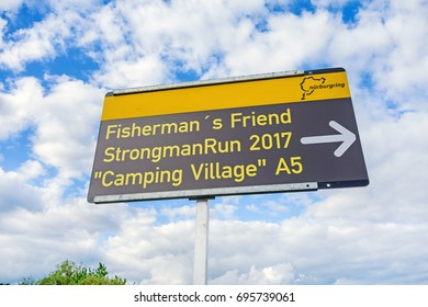 """Nurburg, Germany - May 20, 2017: Event """"Fisherman´s Friend StrongmanRun 2017"""" - an obstacle course at race track Nurburgring / Eifel - sign showing the entrance to Camping Village A5."""