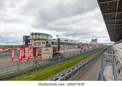 Nurburg, Germany - May 20, 2017: Fishermen's Friend Strongman RUN at race track Nurburgring - start on start finishing straight in front of Mercedes / AMG Lounge.