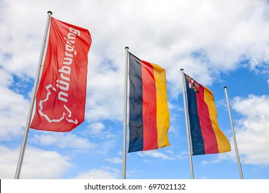 "Nurburg, Germany - May 20, 2017: Flag at race track Nurburgring, labeled with ""Nurburgring"" and logo, two german flags at pole"