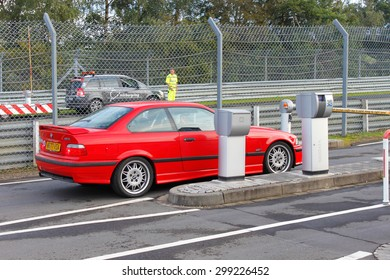NURBURG, GERMANY - SEPTEMBER 16, 2011: BMW M3 at the entrance gates to Nurburgring Race Track.