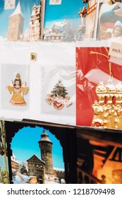 Nuremberg, Bavaria / Germany - 12 18 2009: Postcards with photos and christmas cards with hand painted pewter ornaments at vendor stall at Christmas market
