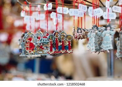 Nuremberg, Bavaria / Germany - Dec 18 2009: Handcrafted and painted, typical German Christmas tree ornaments made of pewter or tin for festive decoration or as souvenir at Christkindles market stall