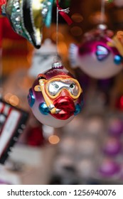 Nuremberg, Bavaria / Germany - December 05 2018: Funny and colorful mouth-blown and hand painted tree ornament in shape of a blowfish with snorkel and diving classes at Christmas market