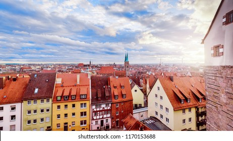 Nuremberg, Bavaria, Germany, Europe. Panoramic view on old city and houses. Spectacular Sunset scenery. Glowing sun in evening light old city. Nuremberg is famous German city and travel destination.