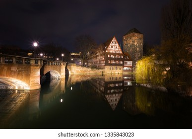 Nuremberg. Bridge over the Pegnitz River and Water tower in night,  Germany