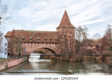 Nuremberg city, Germany - Schlayerturm medieval tower and Kettensteg (Chain Bridge) in winter
