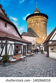 NUREMBERG, GERMANY - 1 MARCH, 2019: Traditional sidewalk restaurant tables with tablecloths in Nuremberg Old Town on 1 March, 2019