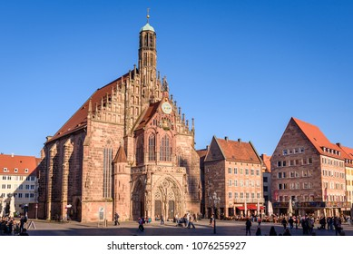 NUREMBERG, GERMANY - April 6th, 2018: Frauenkirche (Our Lady's church) at the Nuernberger Hauptmarkt (central square) in historical Nuremberg town. Nuremberg, Bavaria, Germany. Nuremberg.