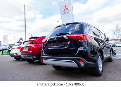 NUREMBERG / GERMANY - APRIL 7, 2019: Mitsubishi logo on a Mitsubishi car at a car dealer. Mitsubishi Motors Corporation is a Japanese multinational automotive manufacturer headquartered in Japan.