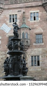 Nuremberg, Germany - August 15, 2017: big fountain with ancient statues and running water flows from the tits