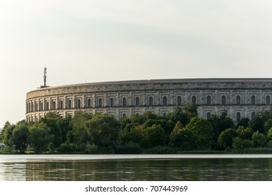 "NUREMBERG, GERMANY - AUGUST 30, 2017: The ""Kongresshalle"" at the lake Dutzendteich in Nuremberg close up"