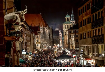"""NUREMBERG, GERMANY - CIRCA DEC 2012 - Big crowds visit the Christmas Market at night circa December 2012 in Nuremberg. Annual """"Christkindlesmarkt"""" is one of the biggest Christmas Markets in the world."""