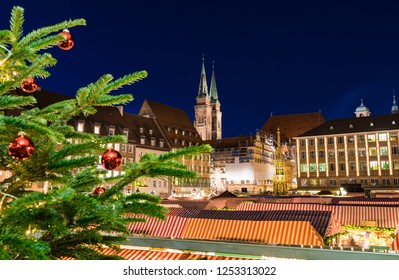 Nuremberg, Germany - December, 05, 2018: View of the roofs of the famous Christmas market, Christkindlesmarkt in the old town of Nuremberg in the evening.