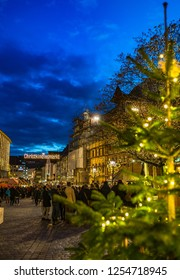 Nuremberg, Germany - December, 05, 2018: Christmas market, people, tourists visit the most famous Christkindlesmarkt in the old town of Nuremberg in the evening.