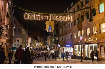 Nuremberg, Germany - December, 05, 2018: Christmas market, the famous Christkindlesmarkt. Street view in the old town of Nuremberg at night.