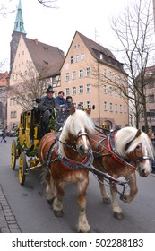 NUREMBERG, GERMANY - DECEMBER 15, 2013: Asian tourists, walking around the city in a horse-drawn carriage