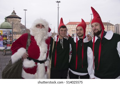 NUREMBERG, GERMANY - DECEMBER 17, 2013: Group of young people dressed as Santa Claus and their helpers, in a square in the historic center of the city