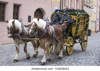 NUREMBERG, GERMANY - DECEMBER 17, 2013: Classic horse carriage, circling the cobbled streets of the old town