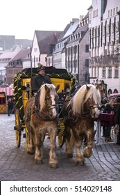 NUREMBERG, GERMANY - DECEMBER 17, 2013: Horse-drawn carriage, along a street in the historic city