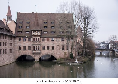 NUREMBERG, GERMANY - DECEMBER 17, 2013: Old mansions and bridges, on the banks of the river Pegnitz