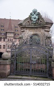 NUREMBERG, GERMANY - DECEMBER 17, 2013: Fence and old well of water, near the river Pegnitz