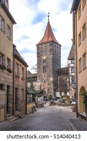 NUREMBERG, GERMANY - DECEMBER 17, 2013: Streets of the medieval city and tower of the imperial castle