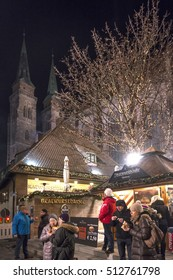NUREMBERG, GERMANY - DECEMBER 18, 2013: People eating and drinking at a kiosk, near the Christmas market
