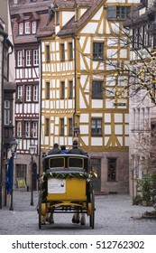 NUREMBERG, GERMANY - DECEMBER 18, 2013: Old postal carriage, circling the historic center of the city