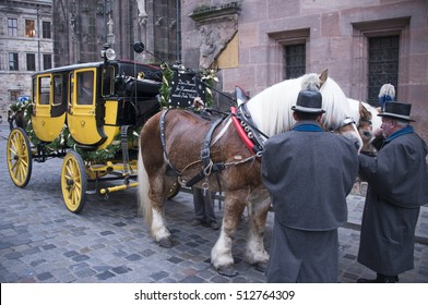 NUREMBERG, GERMANY - DECEMBER 18, 2013: Drivers of a horse car, caring for the animals, in a historic town square