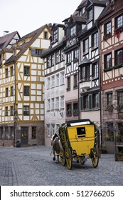 NUREMBERG, GERMANY - DECEMBER 18, 2013: A horse-drawn carriage, runs through the old town