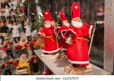 NUREMBERG, GERMANY - DECEMBER 18, 2013: Detail of a figure of Santa Claus, on unfocused background of a kiosk, in the Christmas market