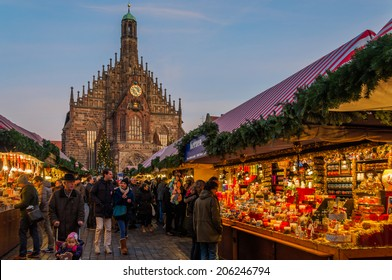 NUREMBERG, GERMANY - DECEMBER 2: People explore Christmas market on December 2 2013. Nuremberg's Christmas Market is one of Germany's oldest Christmas fairs dating back to the 16th century.