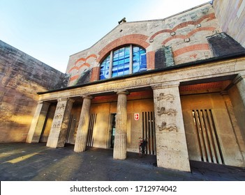 Nuremberg, Germany - January 01, 2020: Germanic National Museum (Germanisches Nationalmusem) in Nuremberg, Germany. Building with sculpture in front.