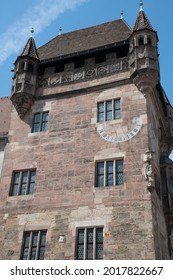 Nuremberg, Germany - July 3, 2021: South facade of the Nassauer Haus (also known as Schlüsselfelder Haus), a medieval tower house in the old town.
