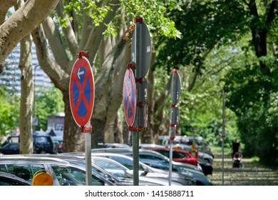 Nuremberg, Germany - June 2, 2019: Signs telling the car drivers that halting is absolutely forbidden around a construction site in a street with cars in Nuremberg