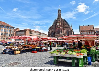 Nuremberg, Germany - June 23, 2018: Market stalls on the market square of the Franconian city of Nuremberg in Germany.