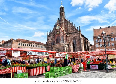Nuremberg, Germany - June 23, 2018: Market stalls in front of the Church of Our Lady in the Franconian city of Nuremberg in Germany.