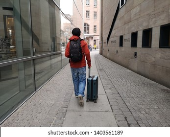 Nuremberg, Germany: March 2, 2019 - Tourist guy arrival to Nuremberg with the luggage for explore in old town of Nuremberg, as is the second-largest city of the German federal state of Bavaria